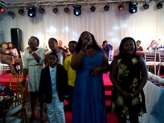 """Granchildren singing """"All of you - John Legend"""" for the celebrant"""